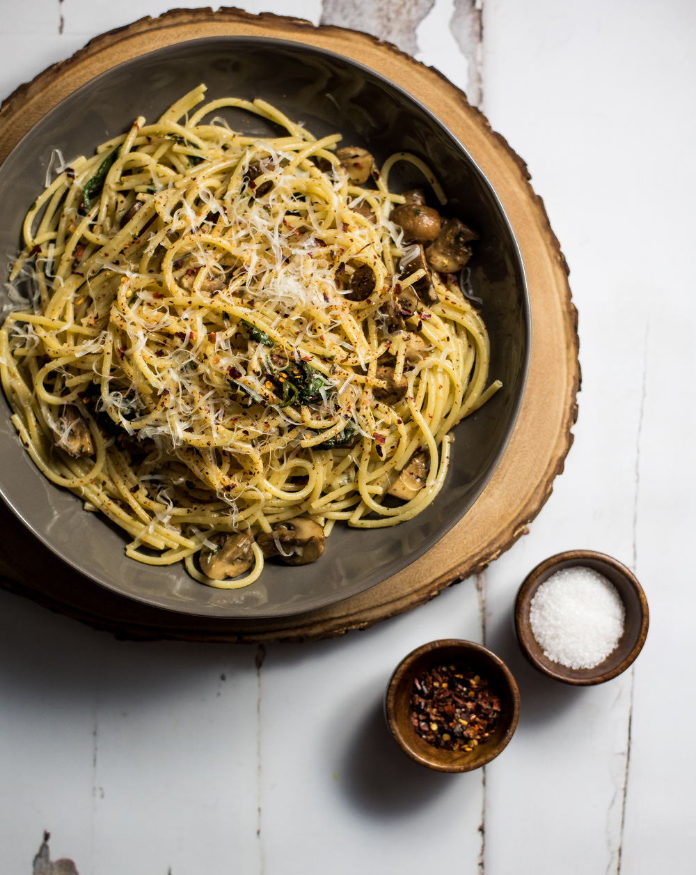 The sound of Spaghetti Aglio e Olio with Wilted Spinach and Mushrooms may sound intimidating, but this classic Italian dish with a twist, is super simple!