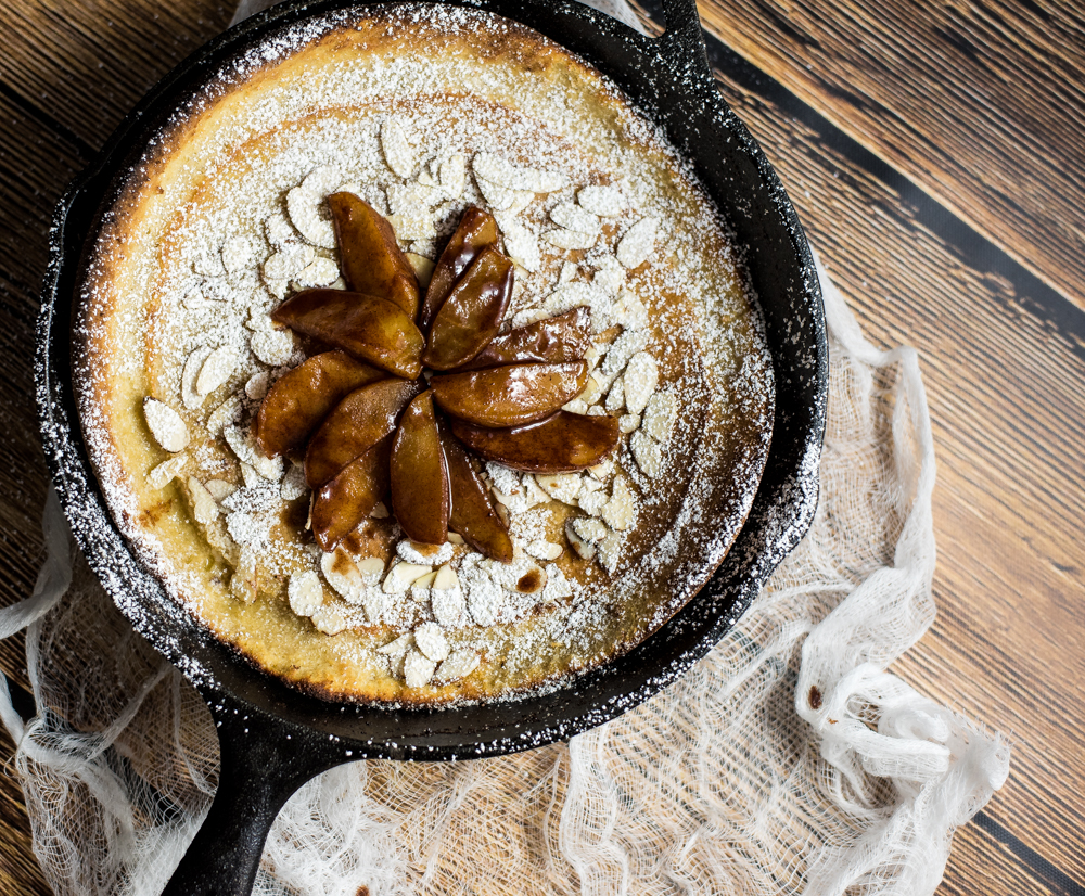 Spiced Apple Dutch Baby is a the perfect fall spin on the classic dutch baby. It is loaded with cinnamon and cardamom and topped with spiced roasted apples!