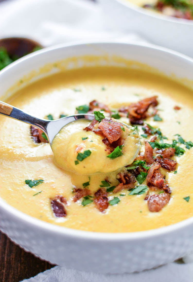 Creamy Beer Cheese Gnocchi Soup is a creamy and comforting soup that's topped with bacon and loaded with cheese!