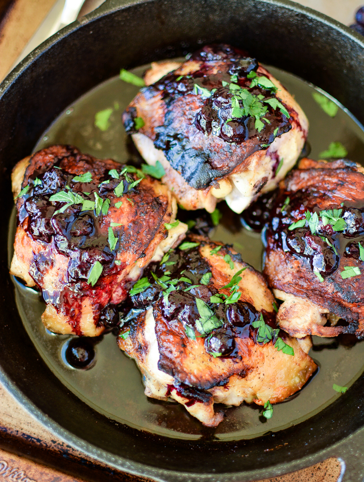 Blueberries in a savory dish is put to the test in this recipe for Crispy Chicken Thighs with Blueberry Sauce! The result: a delicious weeknight fall meal!