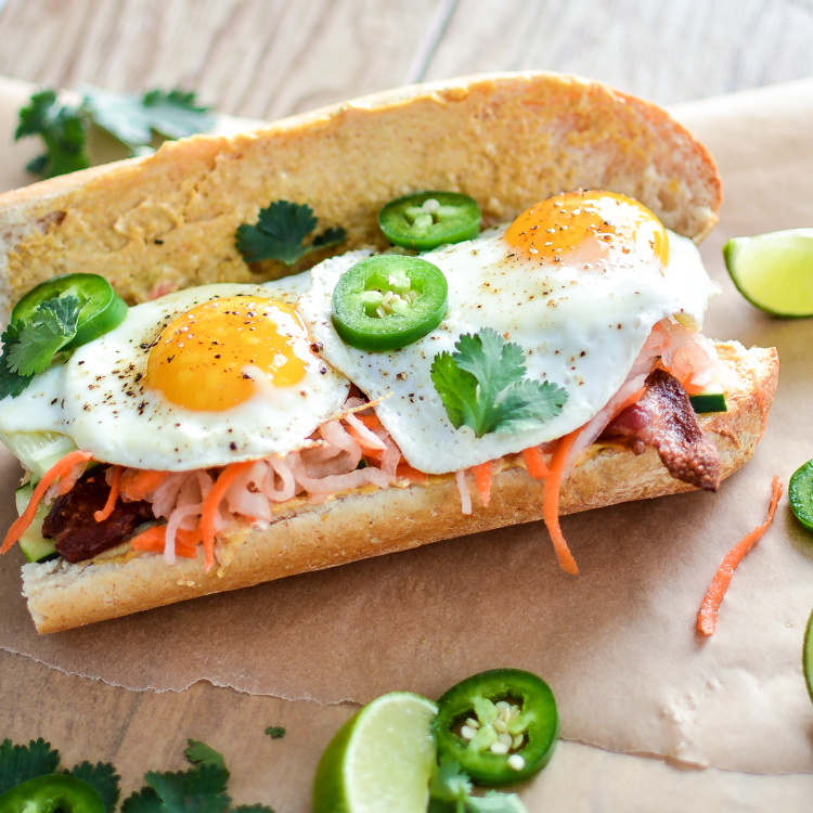 Breakfast Banh Mi sandwiches with Bacon and Curry Aioli are perfect any time of day! | www.cookingandbeer.com
