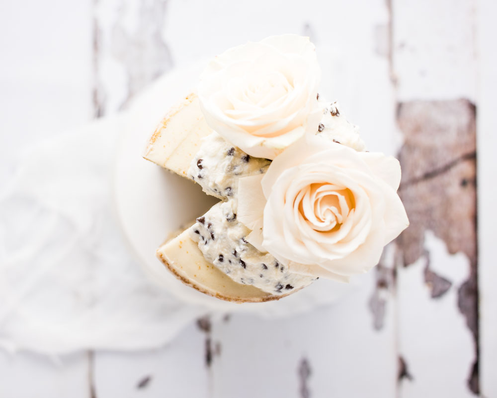 Cannoli Naked Cake is a layered vanilla cake filled with cannoli cream and frosted with vanilla buttercream. It is perfect for the cannoli lover!