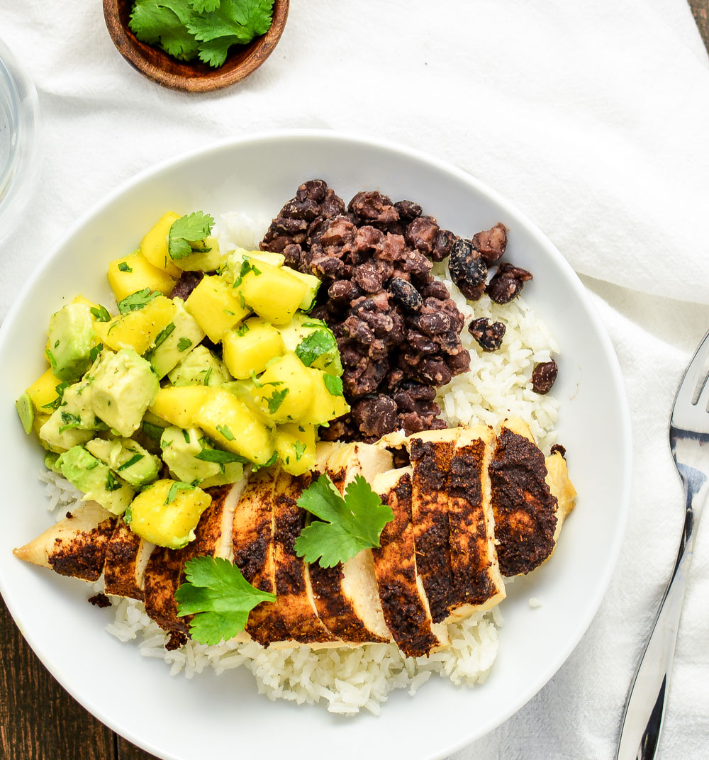 Jerk-Seasoned Chicken and Caribbean Rice Bowls is a light, yet hearty weeknight dinner recipe that's perfect for the whole family!
