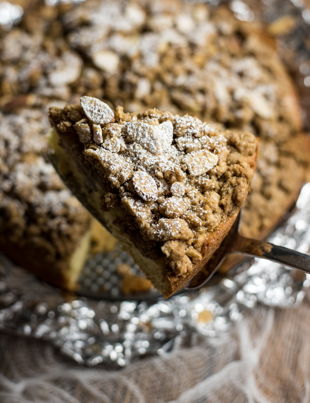 Chai Spiced Pear Coffee Cake is the perfect fall breakfast or dessert recipe. It is loaded with chai spices and topped with a crumbly cinnamon topping!