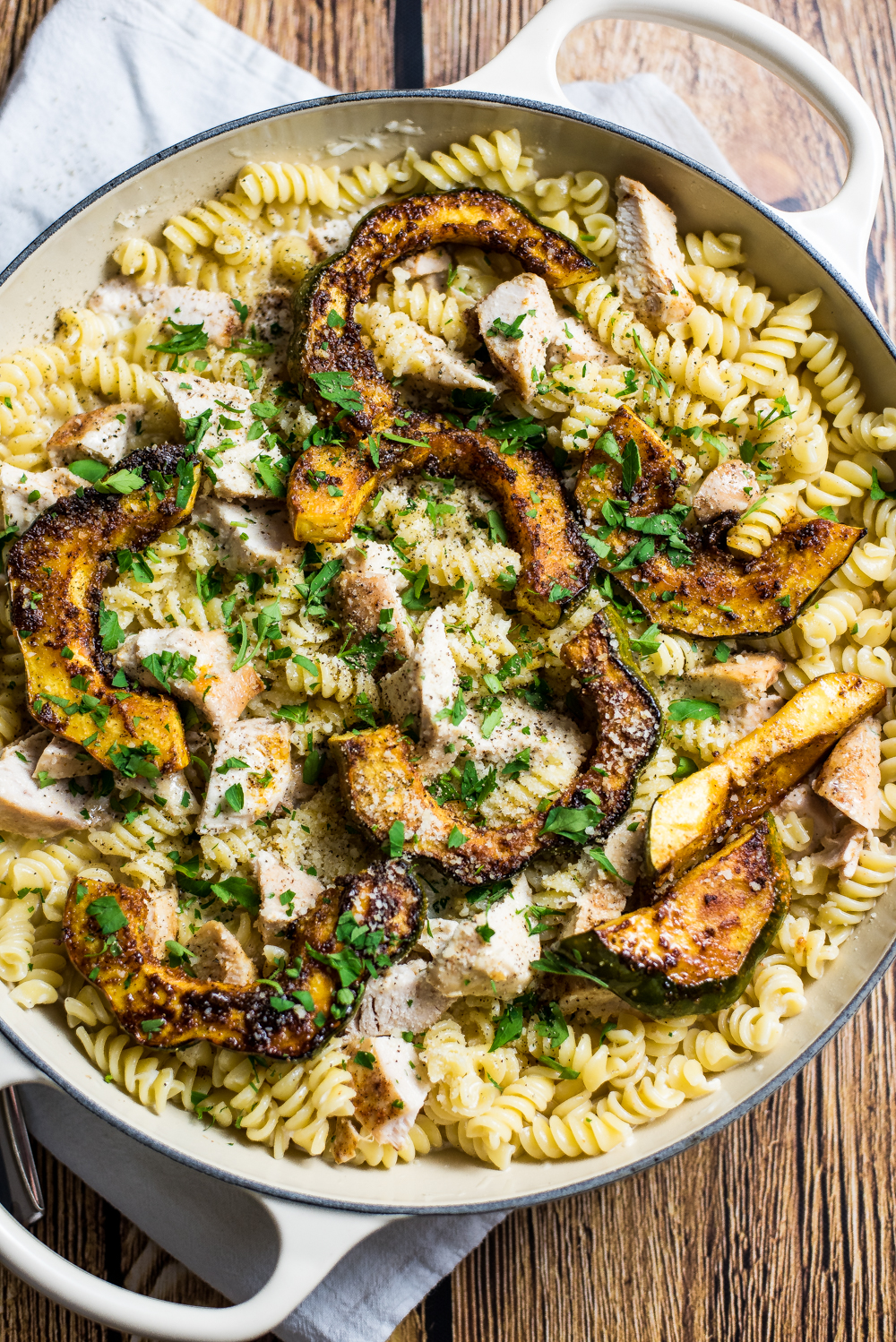 Chicken alfredo pasta with caramelized acorn squash is the perfect fall spin on traditional chicken alfredo. It's one big bowl of comfort!