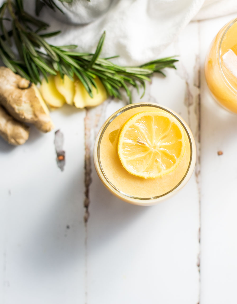 Citrus ginger beer cocktail with candied lemon slices is the perfect drink using 7UP®, fresh ginger, and freshly squeezed orange juice! It is kicked up a notch with both bourbon and pale ale beer creating a flavor explosion!