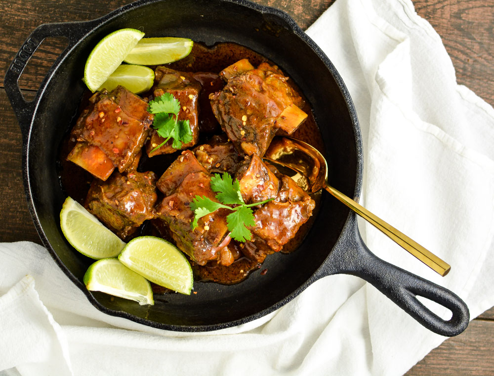 Citrus and Chili Braised Beef Short Ribs are tender, spicy and so full of deliciousness. They are the perfect Sunday supper recipe!
