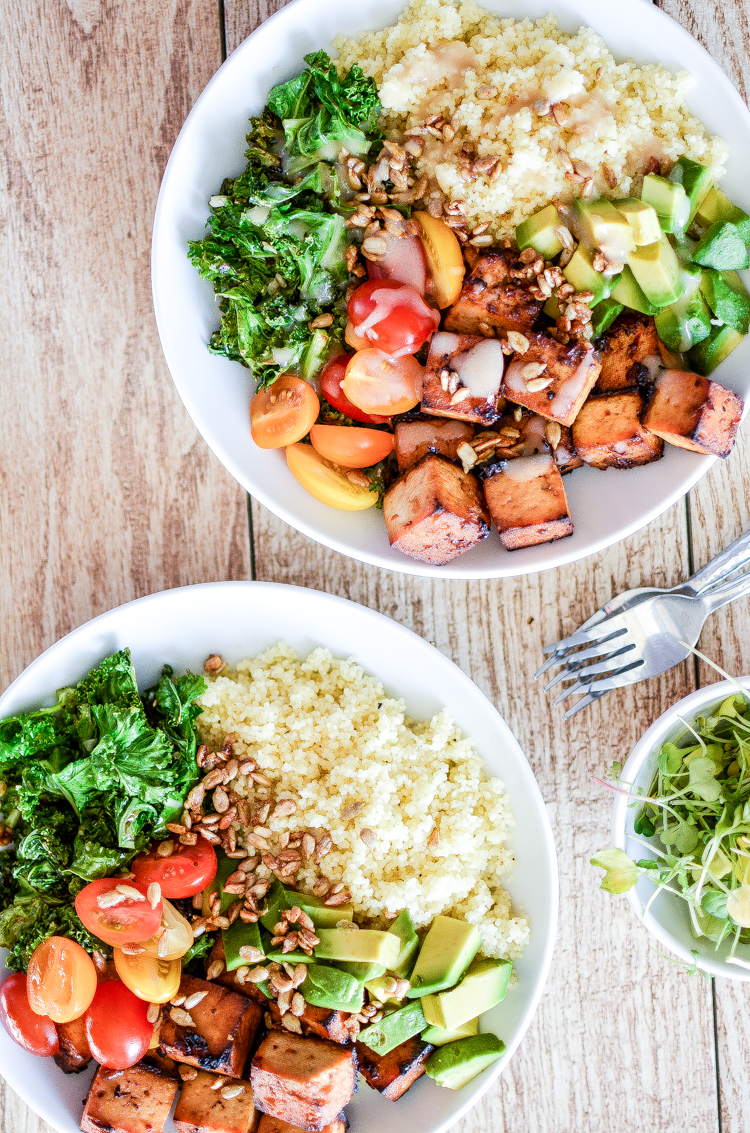 Kale and Couscous Tofu Bowls with Orange Tahini Dressing is a weeknight dinner recipe that is super hearty, filling and packs a lot of flavor! | www.cookingandbeer.com