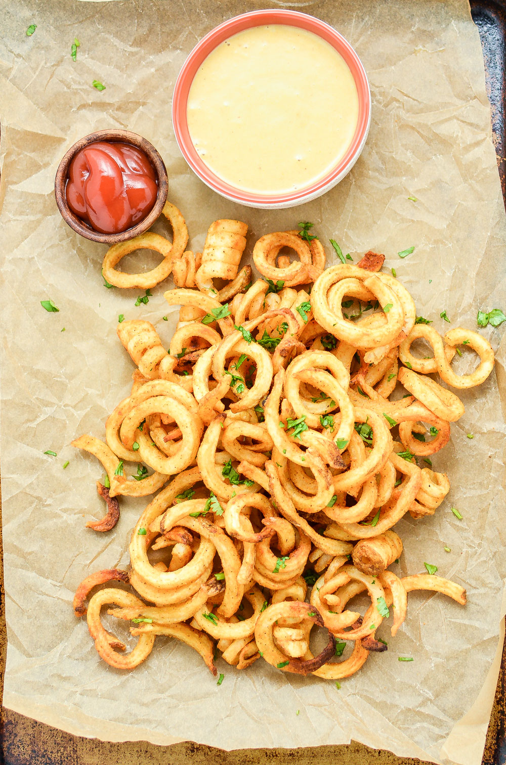 Baked Curly Fries with Mustard-BBQ Dipping Sauce are so easy to make at home and are the perfect side dish!