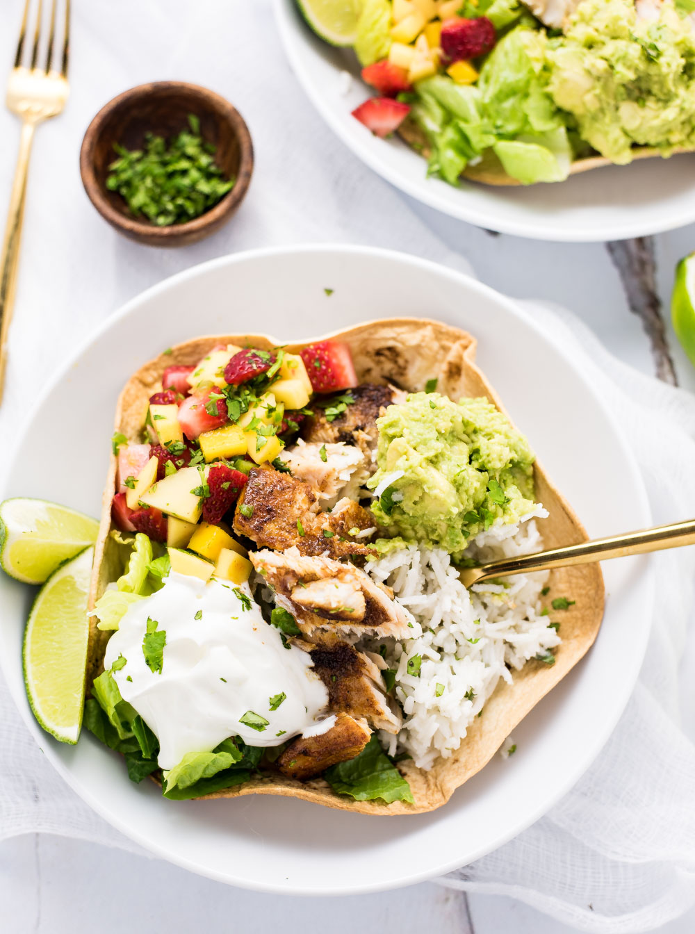 Grilled Fish Taco Burrito Bowls are the perfect weeknight meal. They are a fun twist on Taco Tuesday!