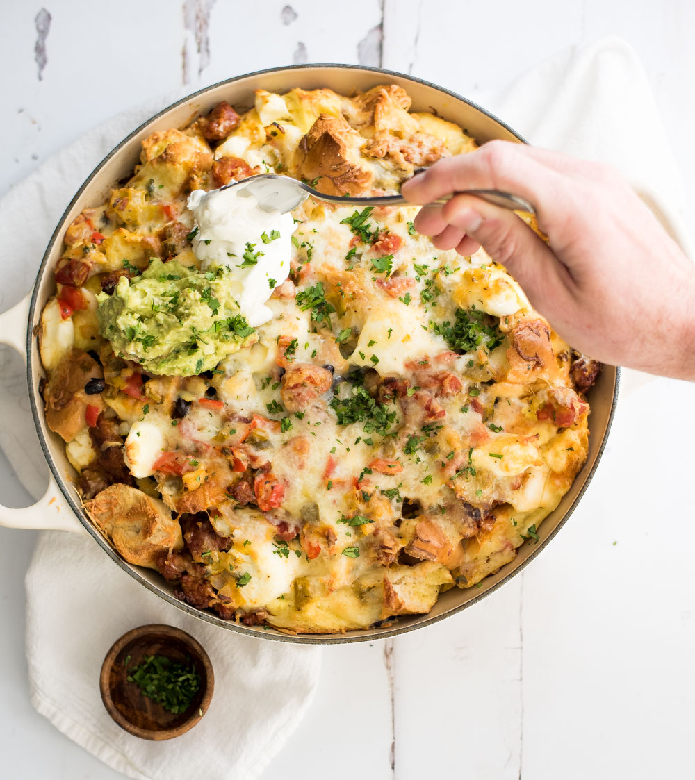 Put a large fun twist on your next breakfast casserole with this huevos rancheros breakfast strata. It's popping with flavor and perfect for a crowd!
