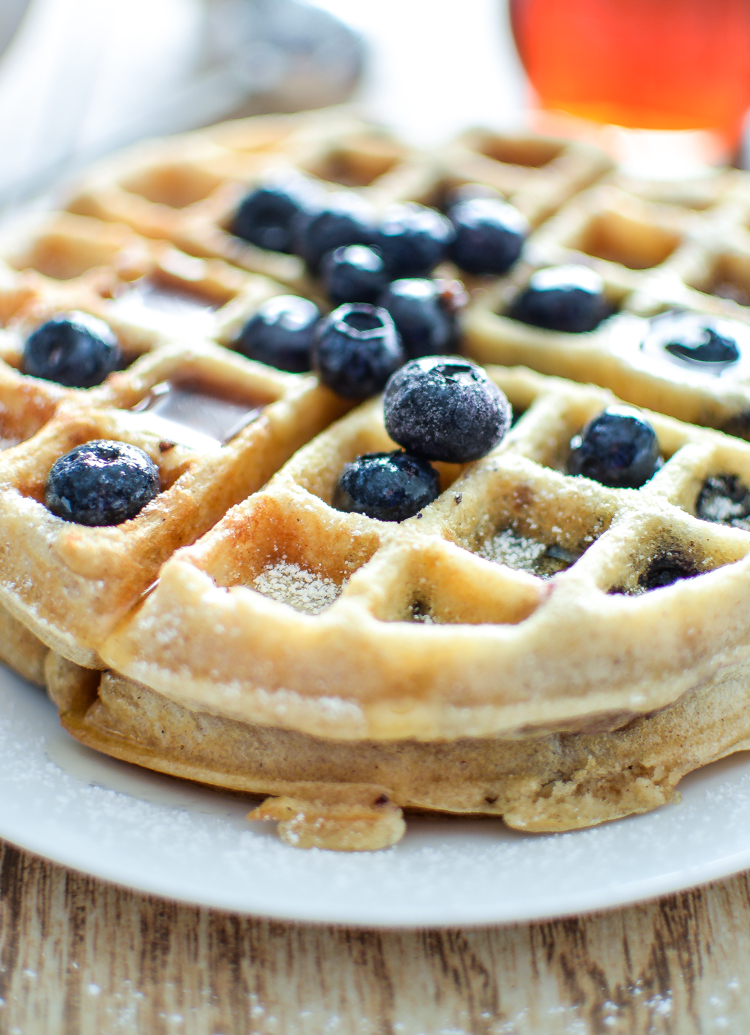 These (Meyer) Lemon and Blueberry Waffles are the perfect recipe for breakfast, brunch or breakfast for dinner! | www.cookingandbeer.com