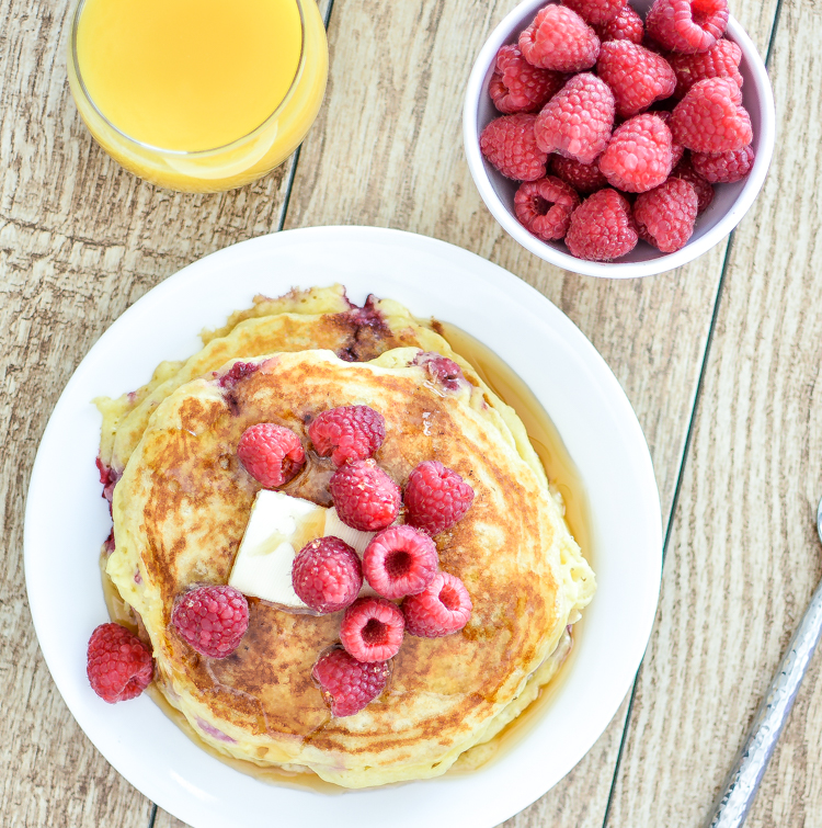 Raspberry Lemon Ricotta Pancakes recipe for breakfast utilizing lemon essential oil! | www.cookingandbeer.com