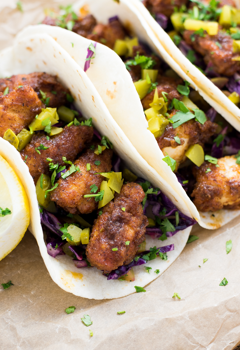Nashville Hot Chicken Tacos with Dill Pickle Slaw are a fun twist on traditional Nashville Hot Chicken: a spicy, fried chicken dish!