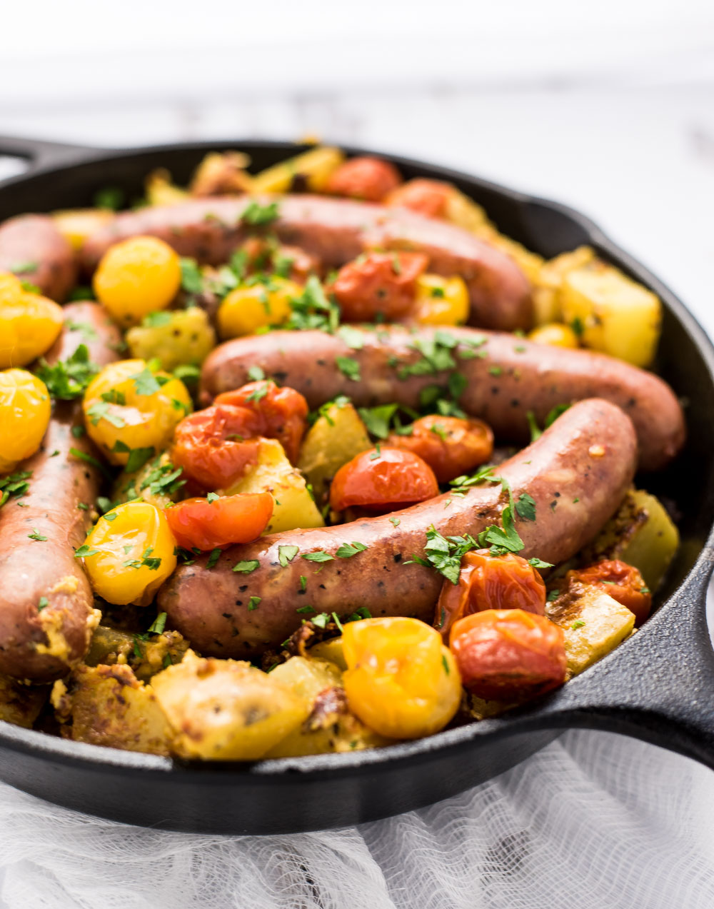 One Pan Roasted Chicken Sausage and Mustard Potatoes is the perfect weeknight meal, adorned with blistered tomatoes and a ton of flavor!
