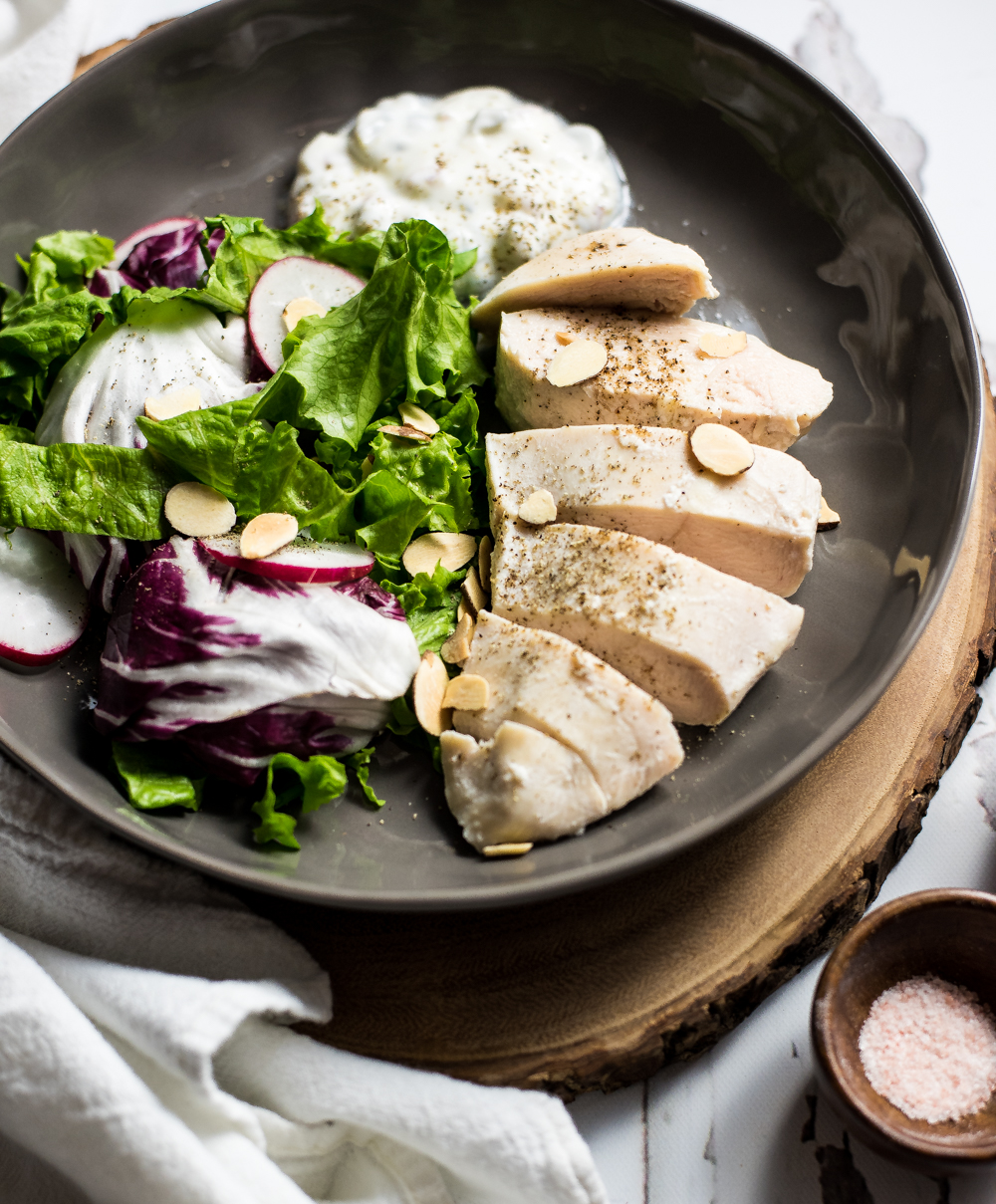Buttermilk-poached chicken with dressed greens is a simple, yet delicious weeknight dinner recipe option. It is loaded with flavor and nutritional value!