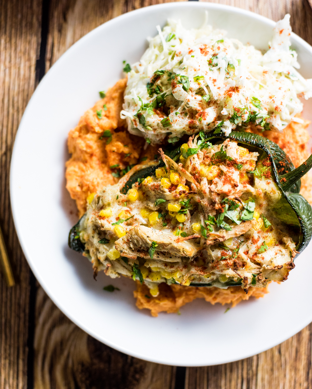 Stuffed poblano and sweet potato mash bowls are the perfect weeknight healthy recipe. It's packed full of flavor that will have you wanting more!