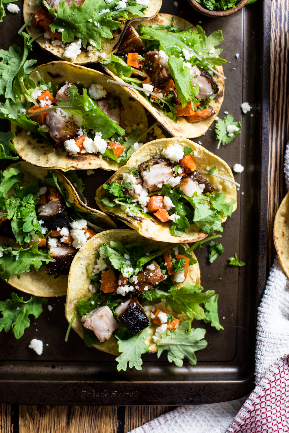 Take your taco Tuesday up a notch, and make these braised pork belly and sweet potato tacos! Crispy, tender pork belly really makes these tacos shine!
