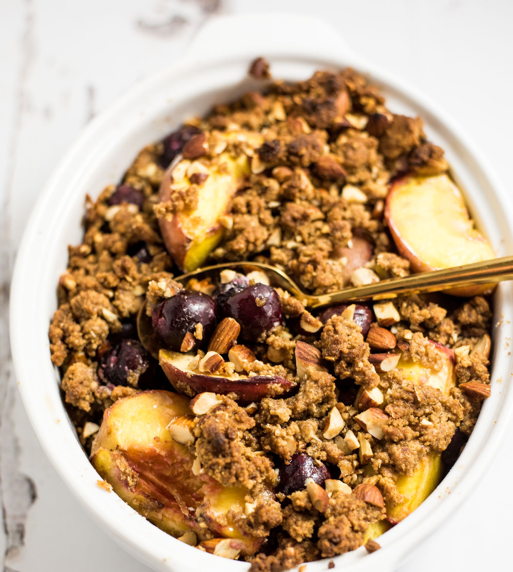 Roasted peaches and sweet cherries with graham cracker crumble is the perfect bright summer dessert that highlight fresh summer fruit!