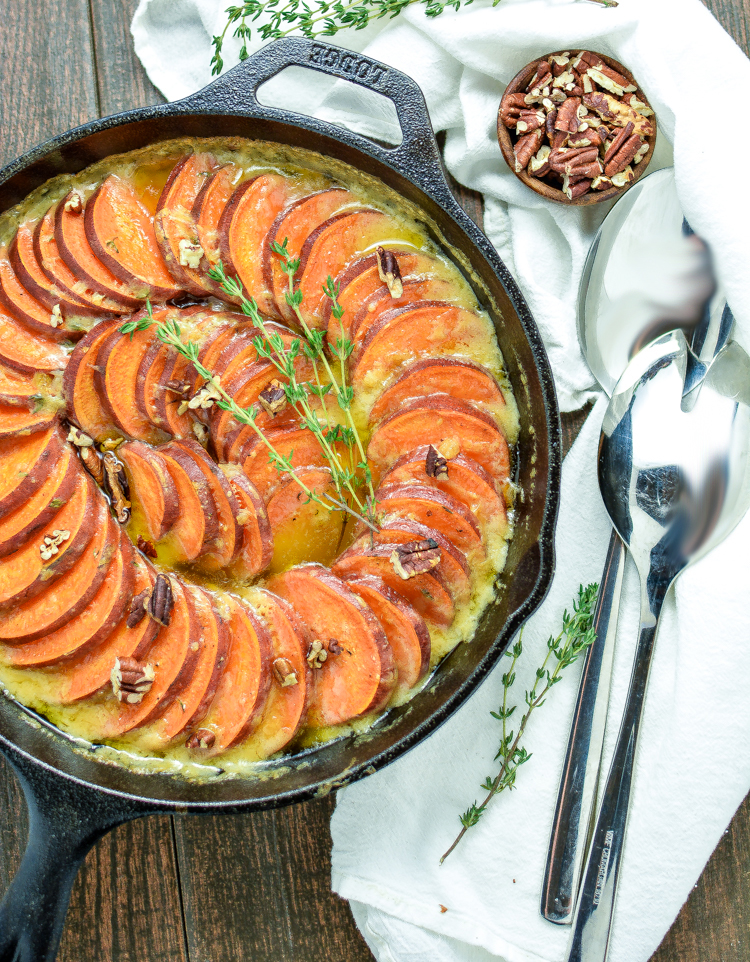 Skillet Scalloped Sweet Potatoes with Maple Bourbon Brown Butter is a must-have side dish recipe for your Thanksgiving Day dinner spreads.