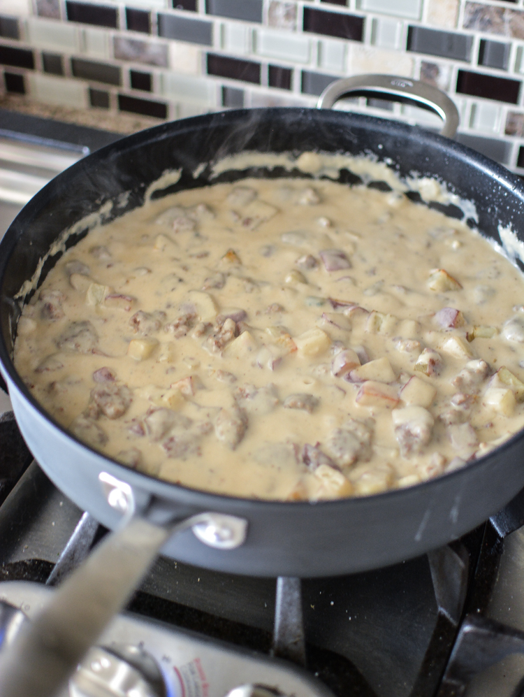 Biscuits and Gravy Skillet Bake: You need this recipe for your next breakfast or brunch party! #OXOCookware   www.cookingandbeer.com