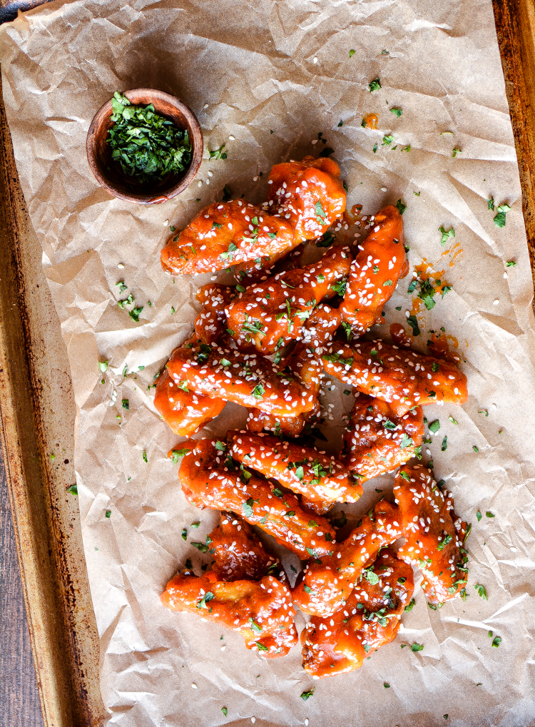 With football season right around the corner, these sriracha honey chicken wings are the perfect addition to your game day menu! | www.cookingandbeer.com