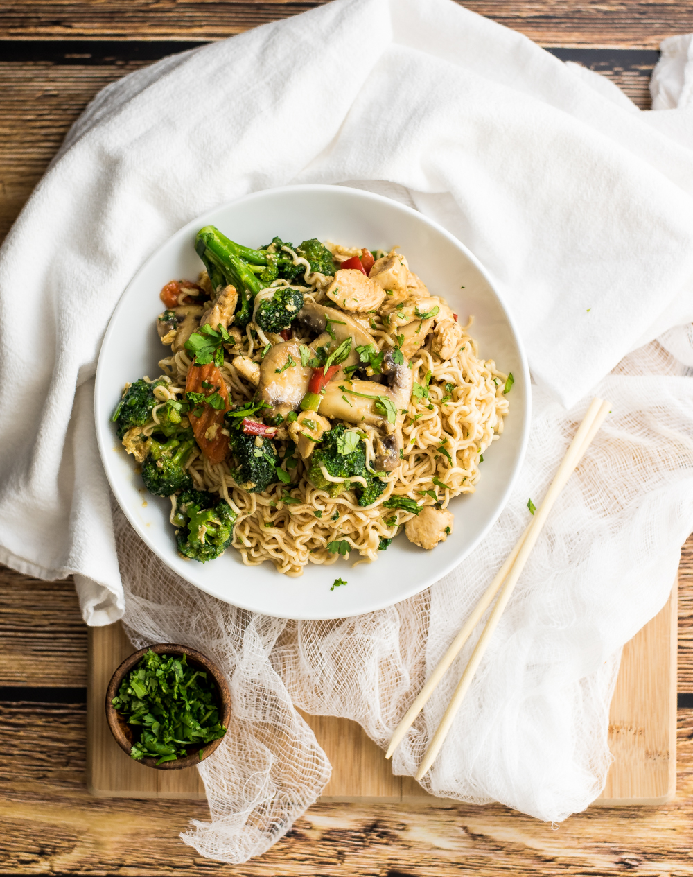 30-Minute Chicken Stir Fry Ramen is the perfect family-friendly weeknight meal. It is on the table in 30 minutes and is exploding with flavor thanks to House of Tsang's General Tso Stir-Fry Sauce!