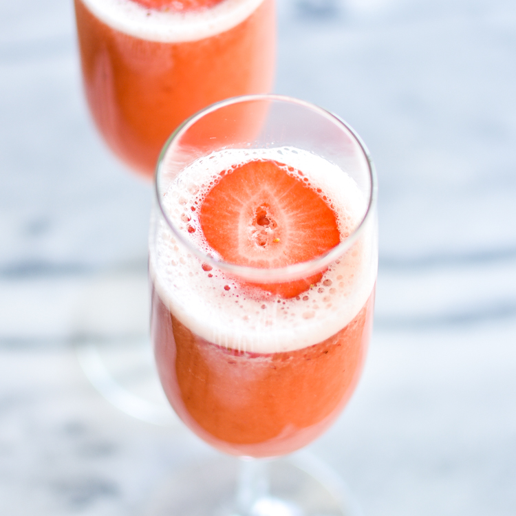 Strawberry Beermosas, combining beer, oj and strawberry puree, are a fun and exciting way to incorporate into your Easter brunch! | www.cookingandbeer.com
