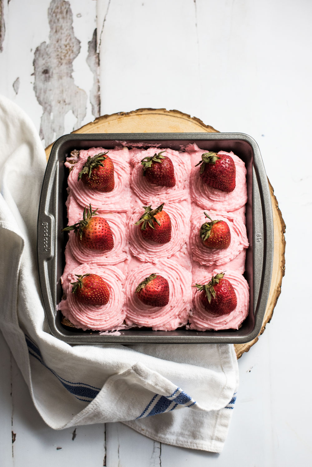These Fudgy Chocolate Stout Brownies with Strawberry Buttercream are the perfect spring treat. They are bursting with strawberry flavor!