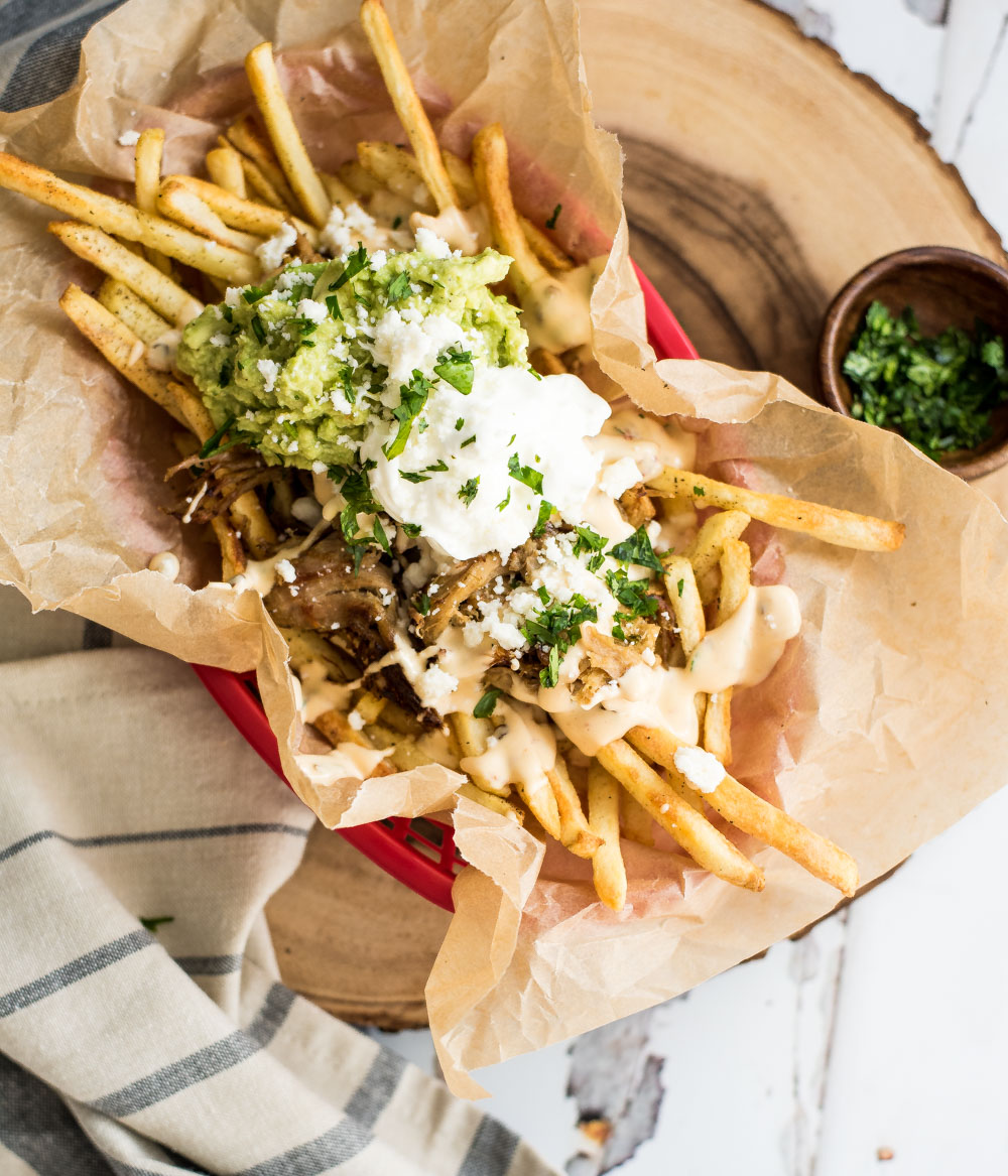 These loaded pork carnitas street fries are the perfect side dish for a Mexican-themed dinner or an appetizer for a small get together!