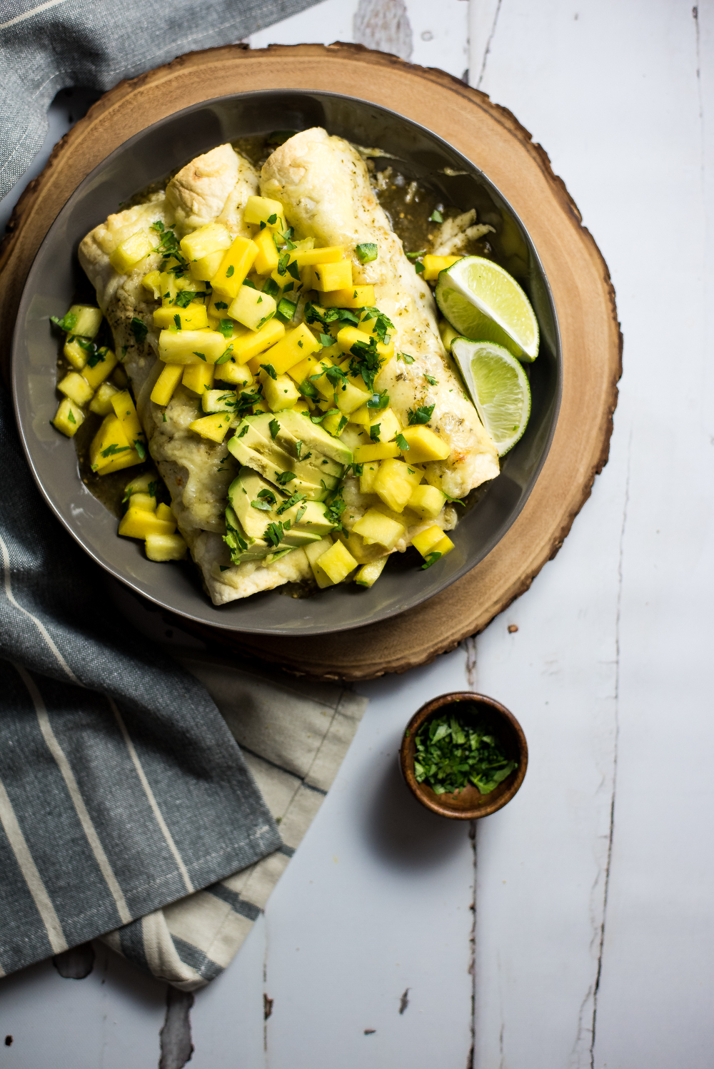 Take your enchiladas to the next level and make these tropical chipotle chicken enchiladas with mango salsa. They will be a hit at the dinner table!