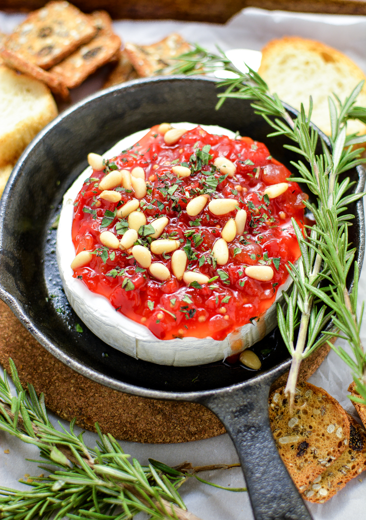 Baked Brie with Sweet Red Pepper Jam is the perfect appetizer recipe to serve this holiday season.